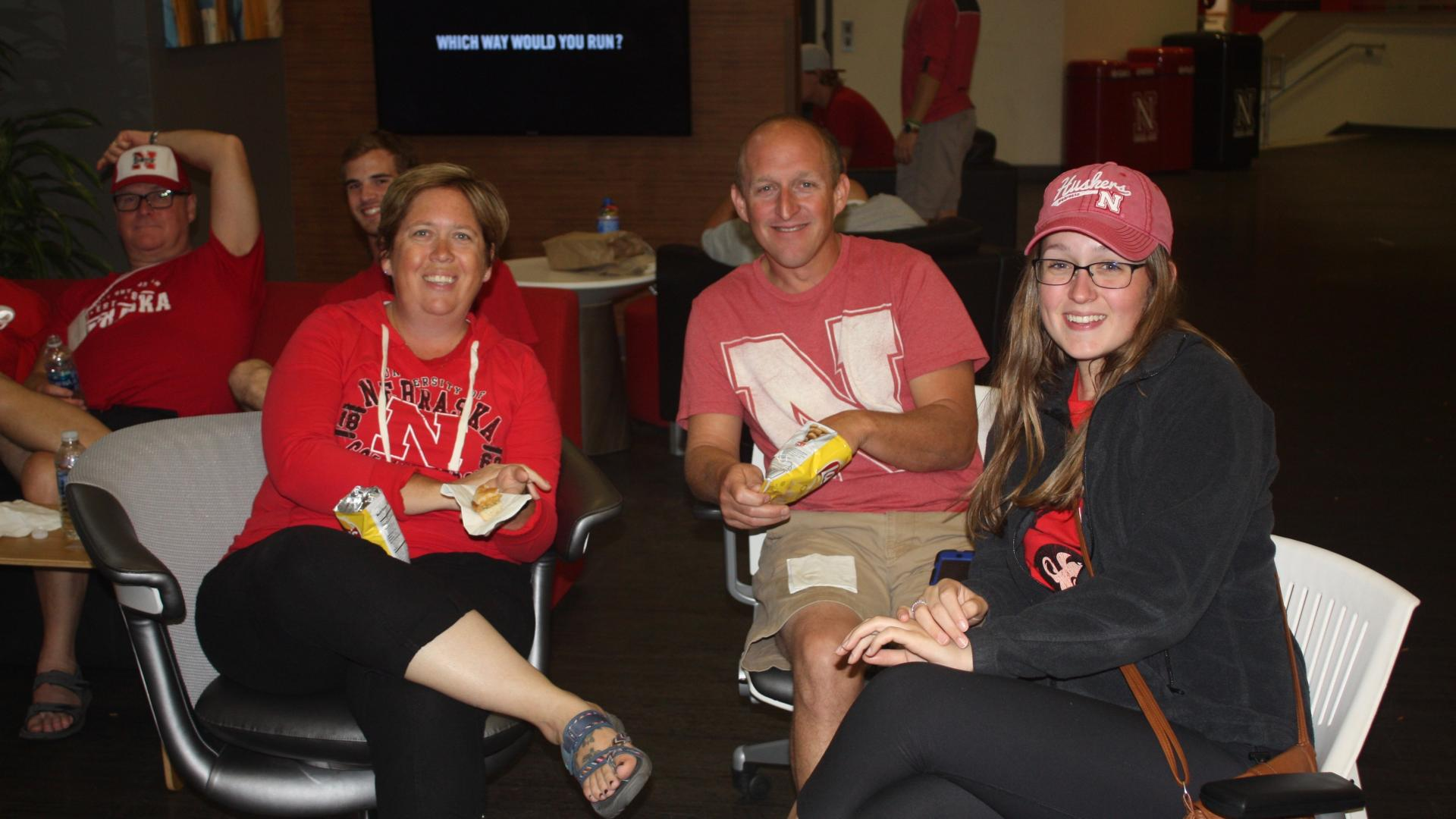 Family at Husker watch party for Family Weekend.